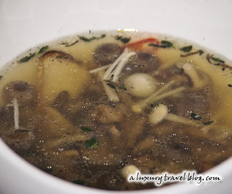 Clear mushroom soup with eryngii and enoki mushrooms