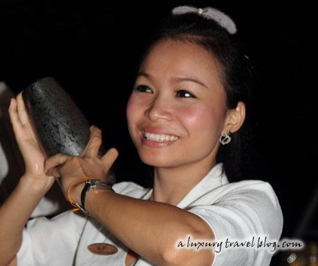 A Thai mixologist shakes a cocktail