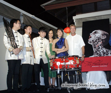 Members of a Chinese orchestra on stage with J-C Nager, General Manager of the Pavilions Phuket
