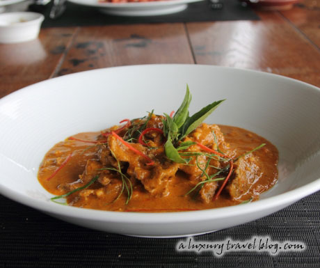 Beef Panaeng curry garnished with Thai basil leaves
