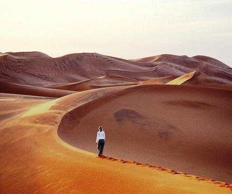 Walking across the sand dunes of Erg Chebbi, Morocco