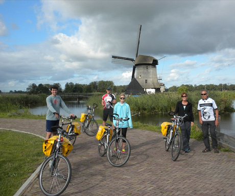 Cycling by a windmill in Holland