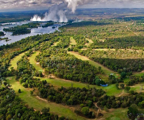 Golf greens with the mighty Victoria Falls in the backdrop � golf safaris in Africa offer adventure and leisure, all on African soil