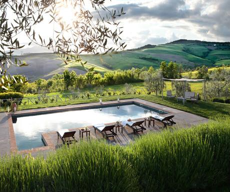 Hosted Villas pool at dusk