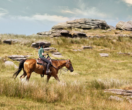 Riding past granite tors on Dartmoor