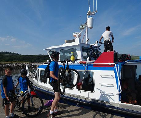 Loading bikes on to MV Sheerwater 2
