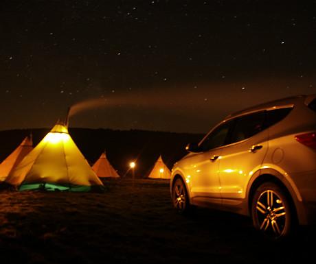 Hyundai tipi camp at night