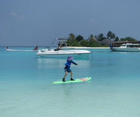Surfing at Four Seasons Maldives Kuda Huraa