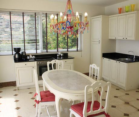 Elounda Gulf Villas villa dining room and kitchen