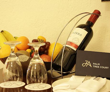 JA Palm Treet Court wine and fruit