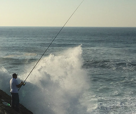 Fisherman on Estoril coastline
