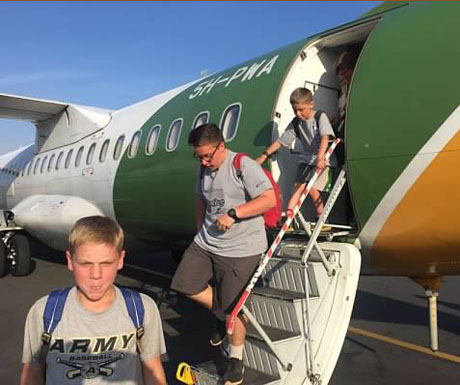 Kids getting off plane