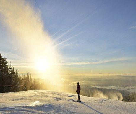 Lady Skier enjoy sunrise on Grouse Mountain