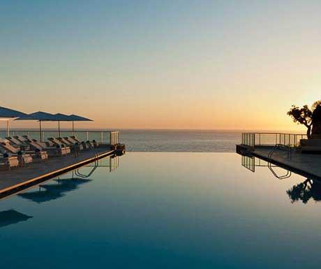 jumeirah-port-soller-hotel-spa-infinity-pool-at-sunset-hero
