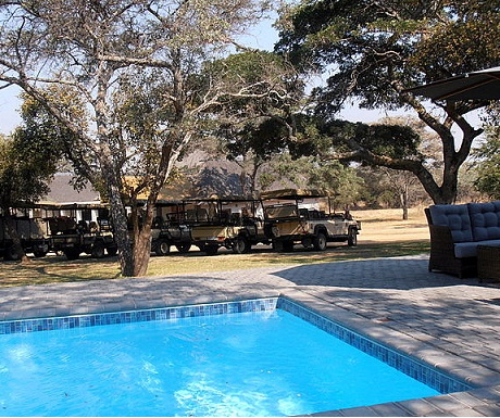 Lovely pool and wild viewing landrovers at Monate Game Lodge