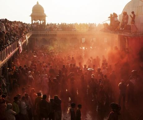 Holi festival enjoying by a crowd in Krishna Temple