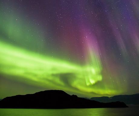 Aurora borealis over the Vaigat Strait at Tartunaq, Greenland