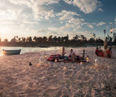Romantic Christmas dinner on the beach at Tongabezi, Livingstone, Zambia