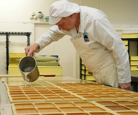 Quiggins Kendal mint cake being put in moulds