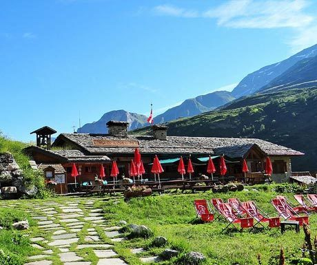 Mountain hut in sunny spring