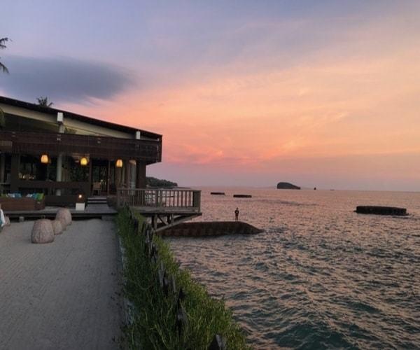 Orange sunset ocean front restaurant