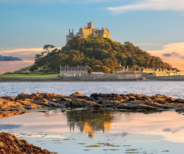 castle on hill in sea cornwall