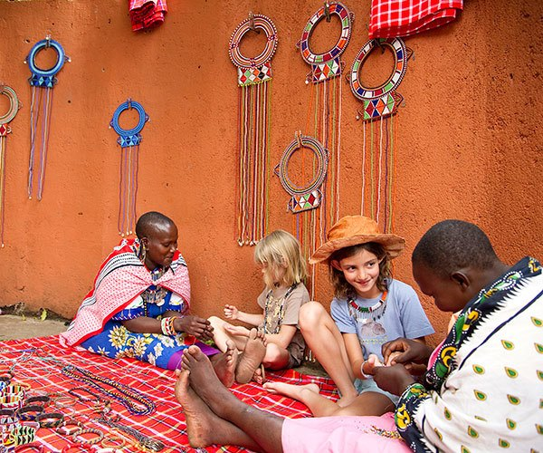 Children doing crafts with Maasai women, Sanctuary Olonana