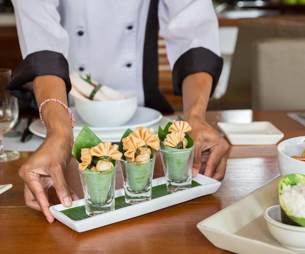 Chef preparing Thai cuisine at Baan Mika, a luxury 6 bedroom beach front villa located on Plai Laem Beach, Koh Samui, Thailand