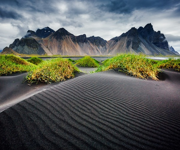 Rippled black sand beach backdropped by the impressive Vestrahorn mountain in Stokksnes cape in springtime, East Iceland