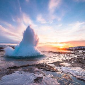 Eruption of Strokkur geyser on the popular Golden Circle Route in Iceland.
