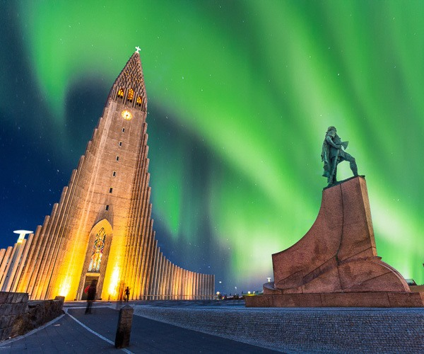 Iceland's capital and the Northern Lights above
