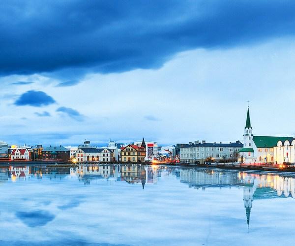 A serene view of the Tjornin lake in Reykjavik city center, Iceland