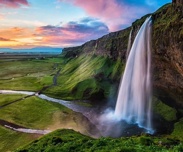 Seljalandsfoss waterfall, a perfect location to enjoy summer's midnight sun in South Iceland