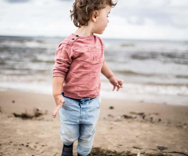 Child on Porth Iago beach, North Wales