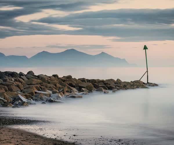 The rugged landscape of Dinas Dinlle beach near Caernarfon